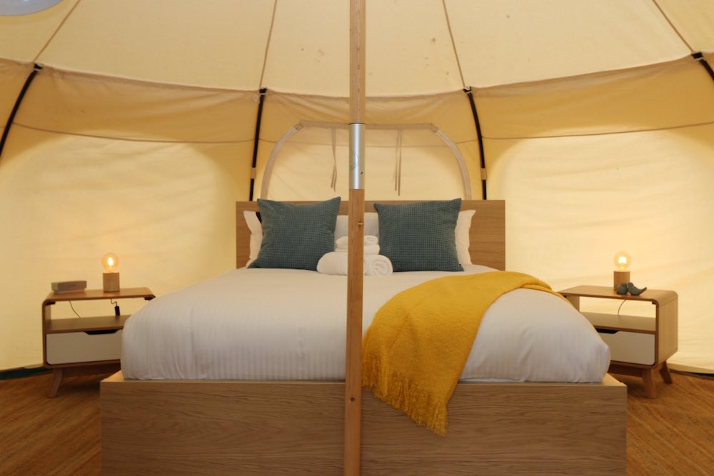 Daylesford-Glamping-Serenity-- Queen Bed with Side Tables and Green Cushions
